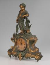 FIGURAL BOY WITH FISH MANTLE CLOCK