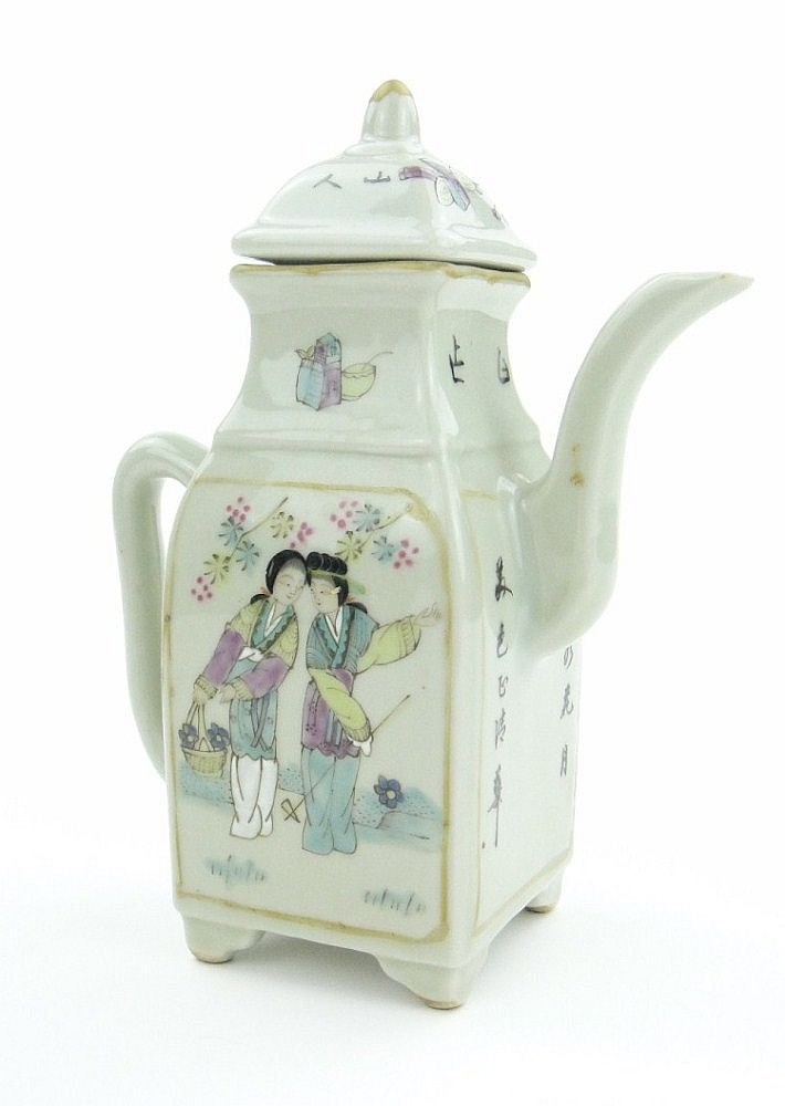 A Chinese porcelain teapot with painted designs of