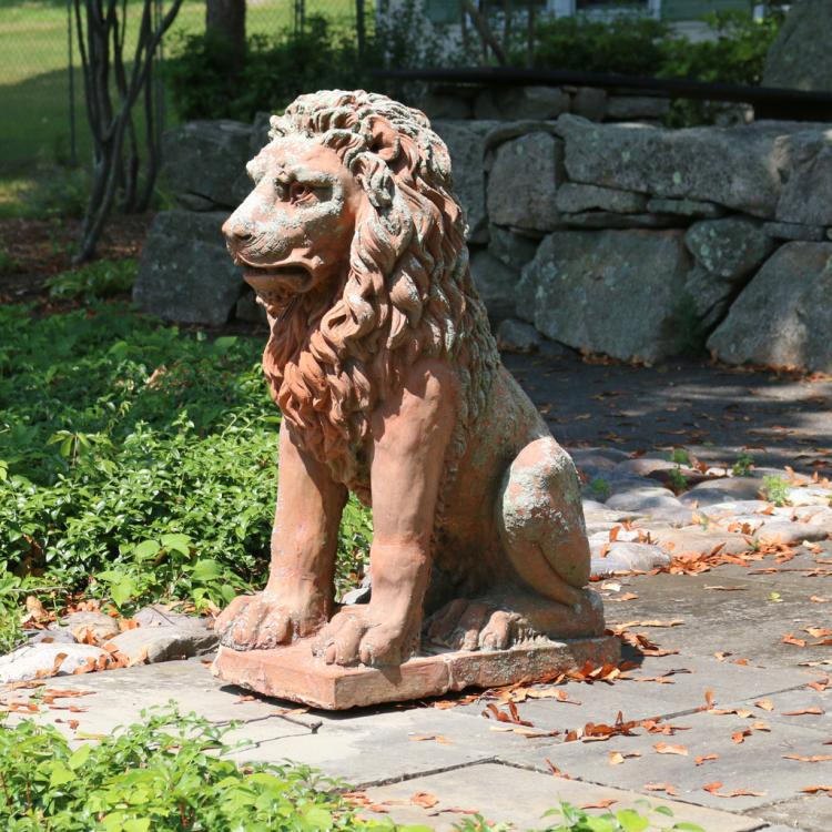 TERRACOTTA SEATED FIGURE OF A LION