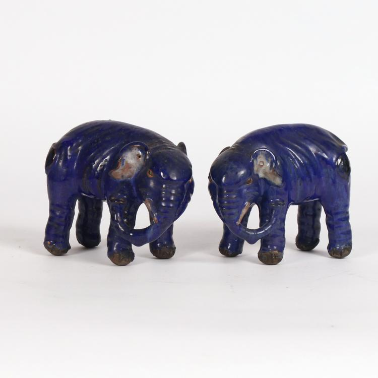 PAIR BLUE GLAZED EARTHENWARE ELEPHANTS