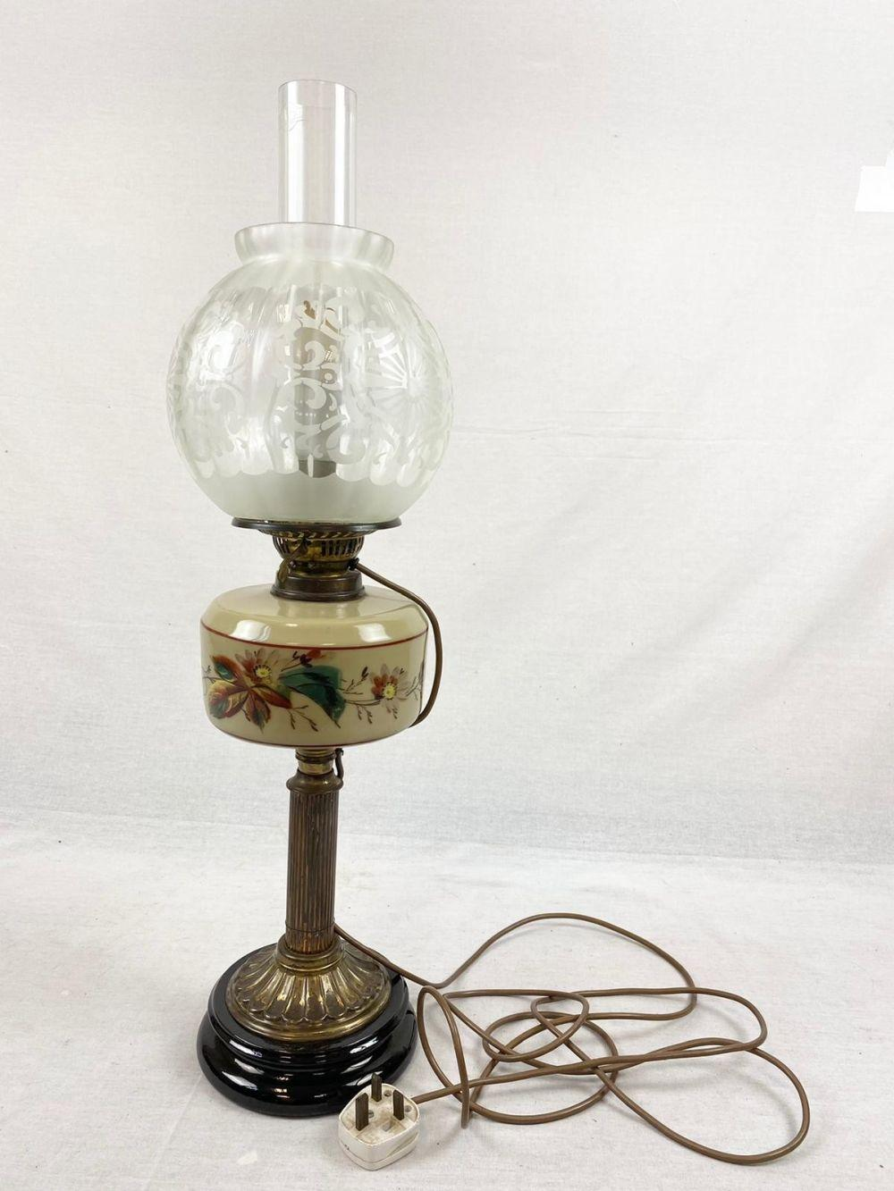 Victorian Milk Glass Oil Lamp Converted to Electric. Floral decorated chamber and milk glass sat above a brass central column. The globe is made of beautifully etched glass. In full working order. 68cm tall