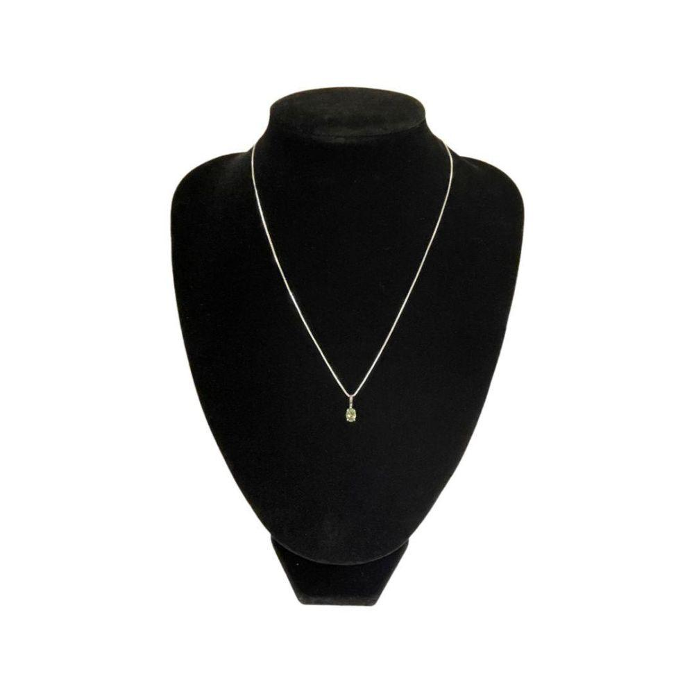 9ct white gold and tourmaline pendant on white metal chain.