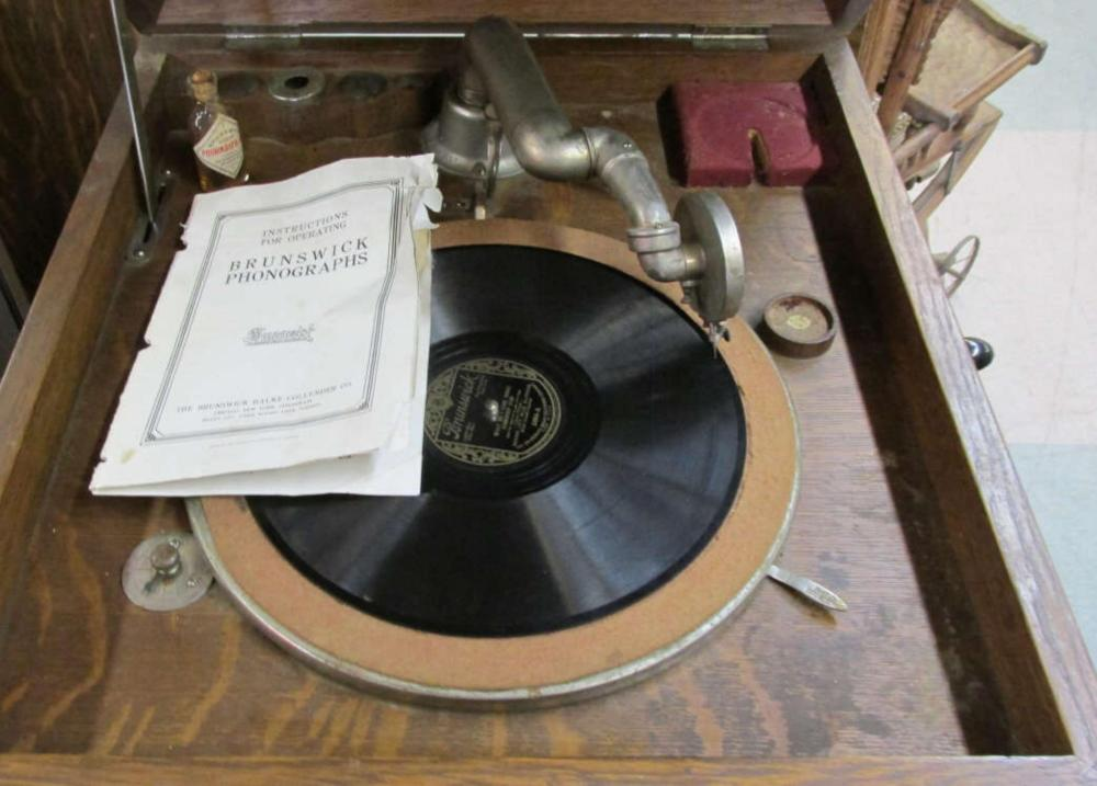 Brunswick Antique Phonograph With Records