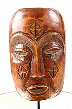 Fossilized Bone carved tribal mask diamond design
