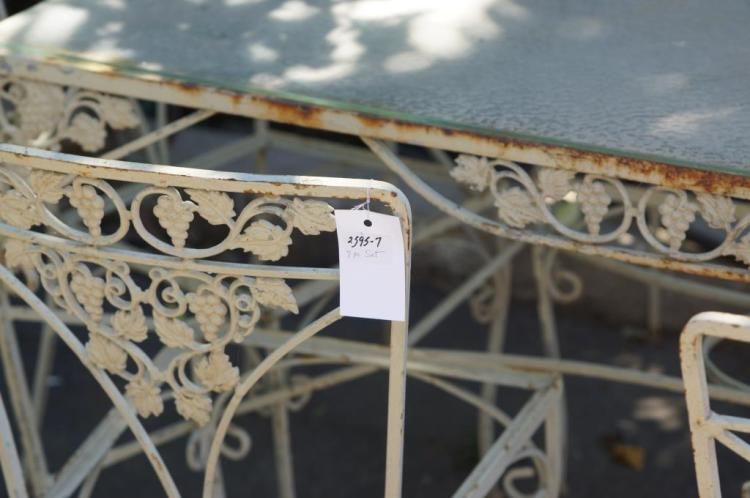 Lot 122 Wrought iron patio table & chairs
