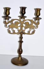 Brass Polish antique candlestick/lion motif