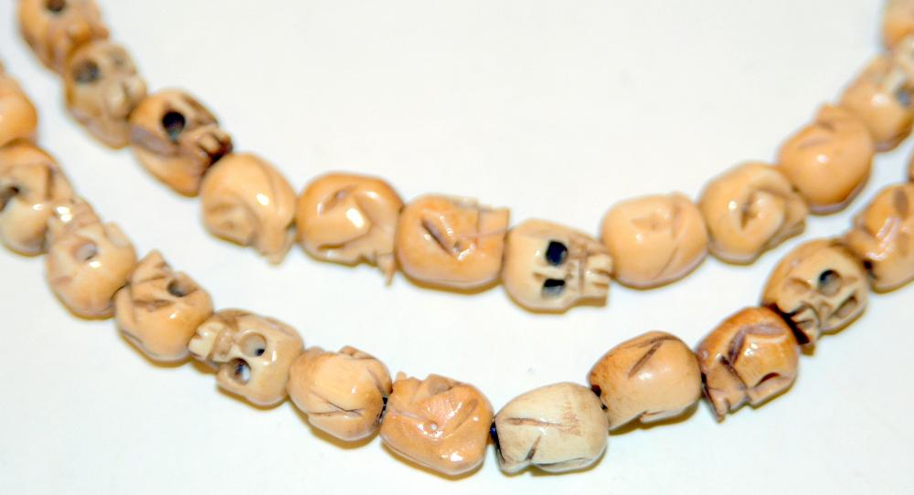 Well Carved Bone Skull Necklace