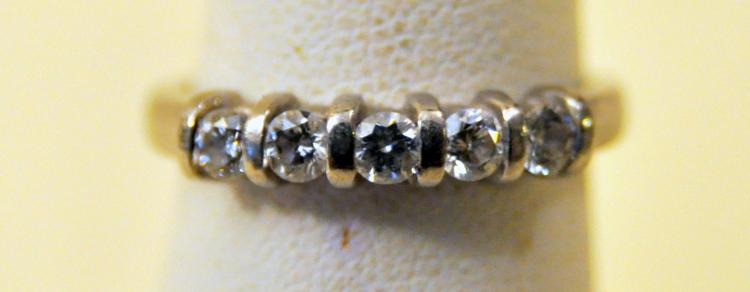 Platinum diamond band signed