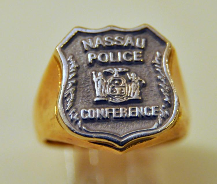Police ring Nassau gold seal of NY