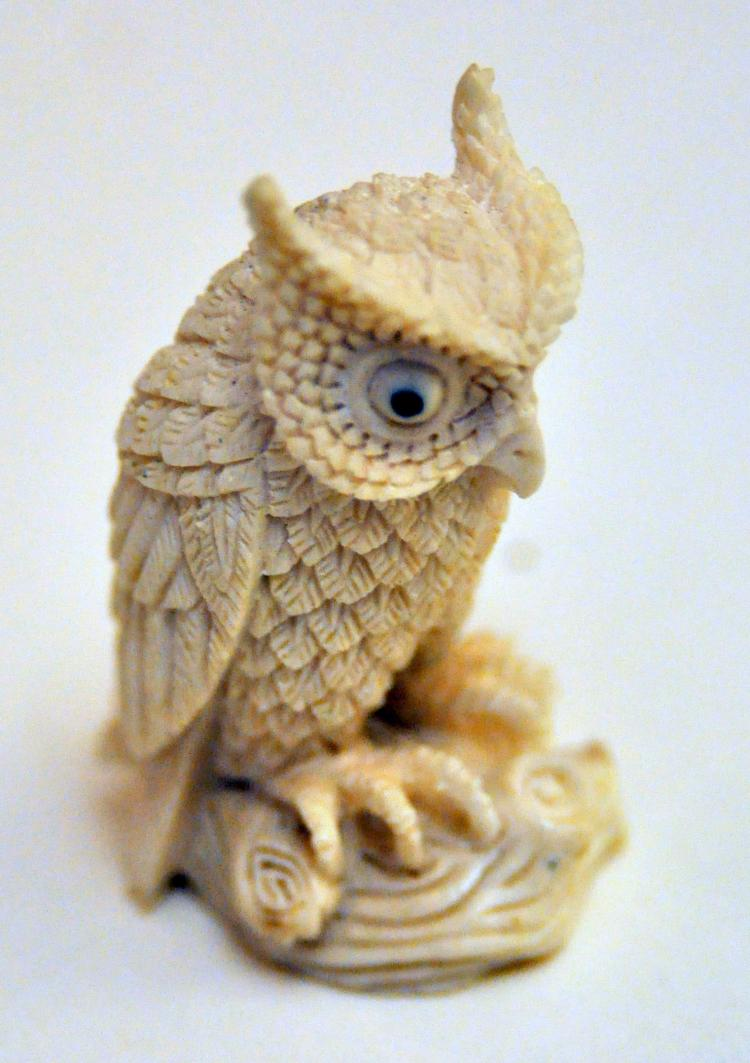 Snow owl carved bone statue
