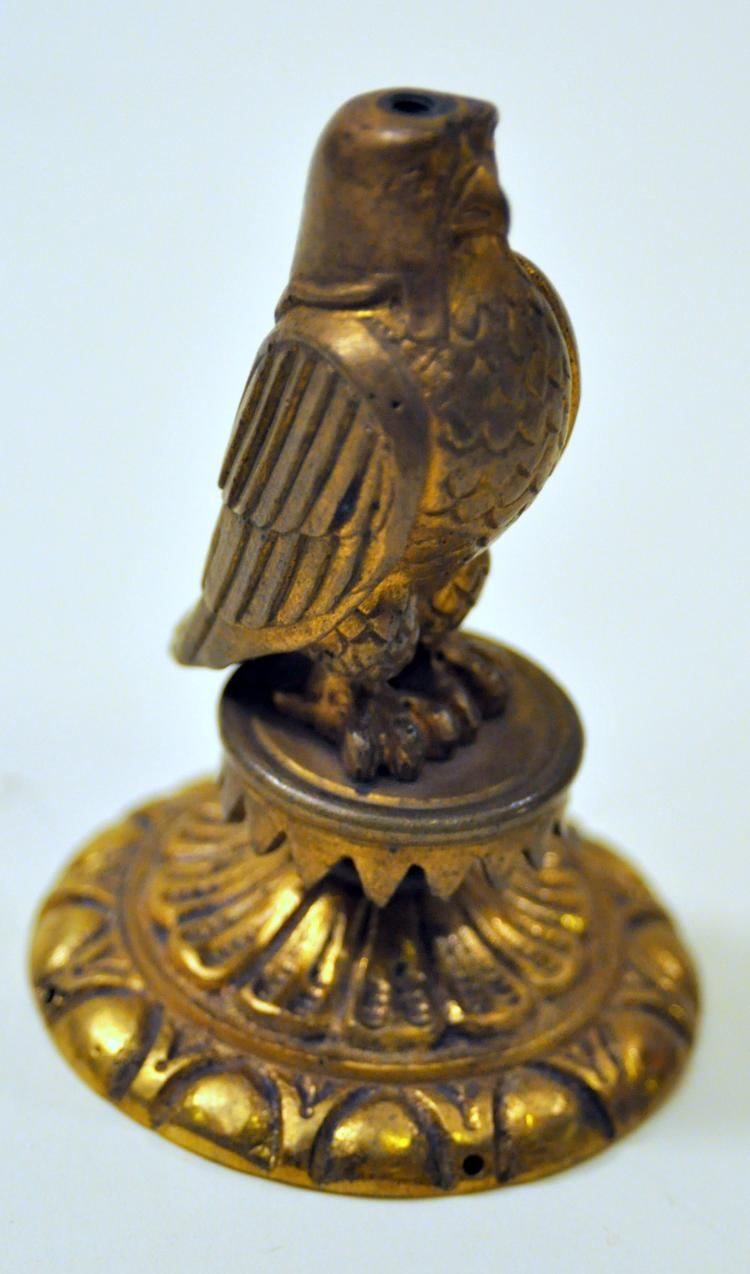 Brass falcon statue base