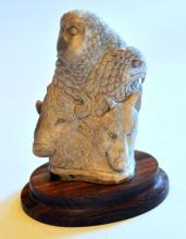 Carved elk antler totem eagle