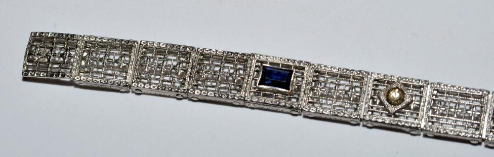 Lot 60: Filigree piercework bracelet sapphires