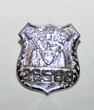 Lot 62: Sterling police badge NY city