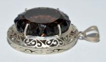 Lot 75: Fancy cut smoky quartz piercework set pendant