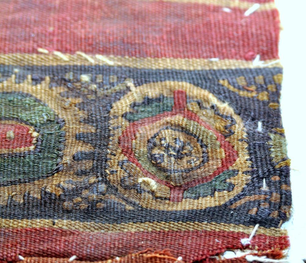 Lot 96: Coptic fabric maroon red