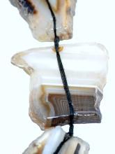 Lot 121: Sliced banded agate necklace