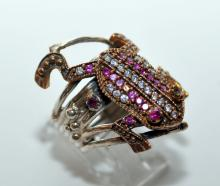 Lot 178: Sterling frog ring rubies