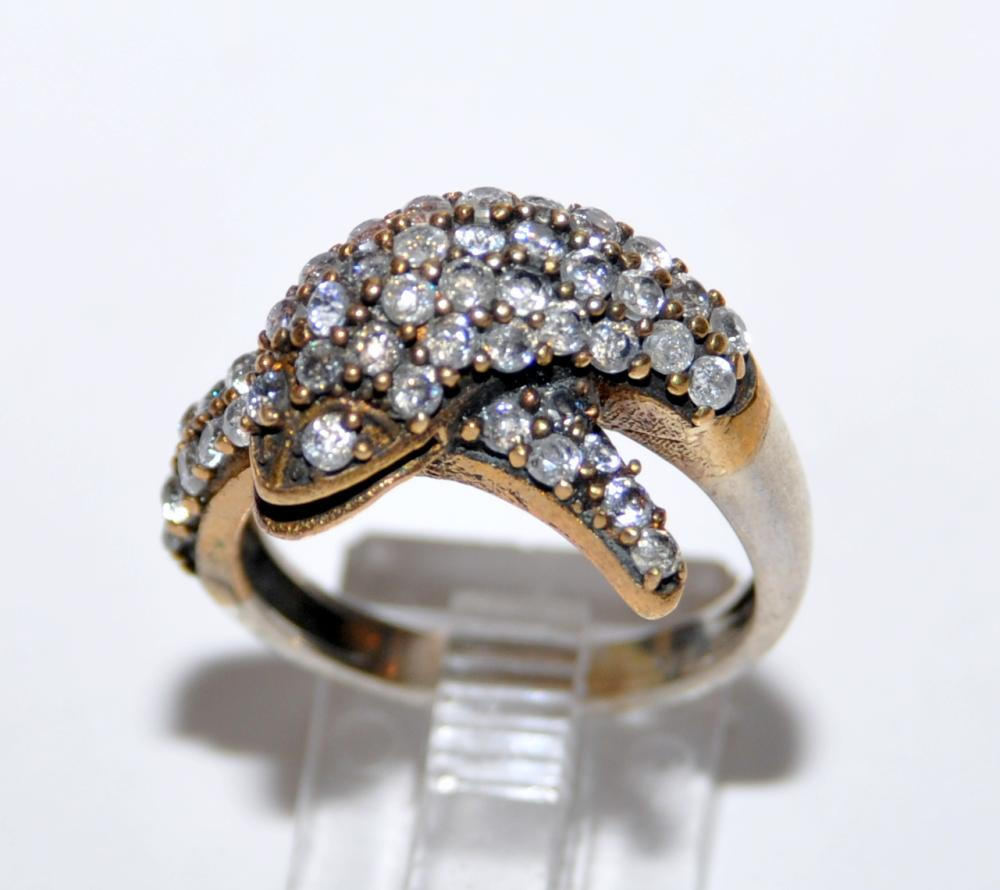 Dolphin ring encrusted stones