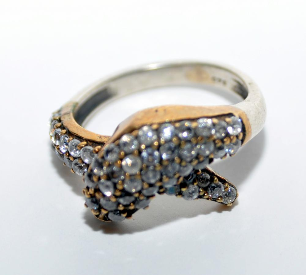 Lot 179: Dolphin ring encrusted stones