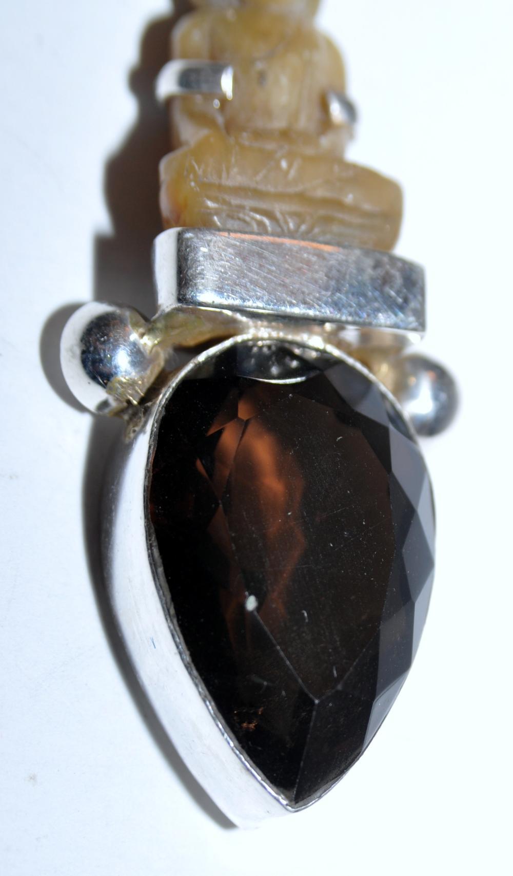 Lot 183: Silver Buddha pendant carved custom