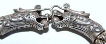 Lot 203: Dragon head bracelet silver color