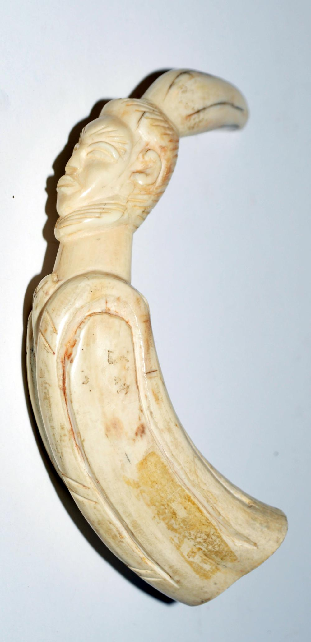 Wart hog tusk carved African figure