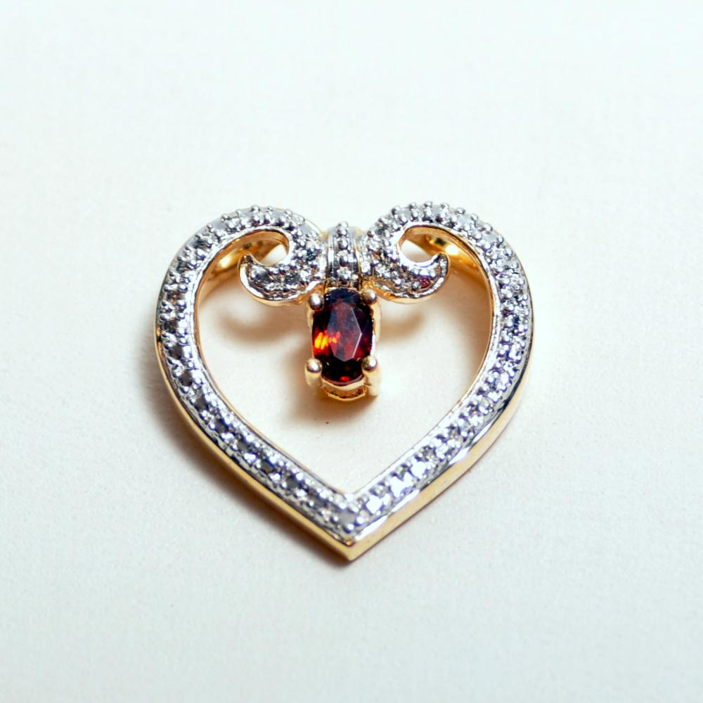 Lot 227: Sterling heart garnet pendant vermeil
