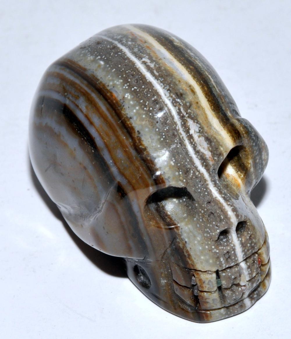 Skull carving banded agate