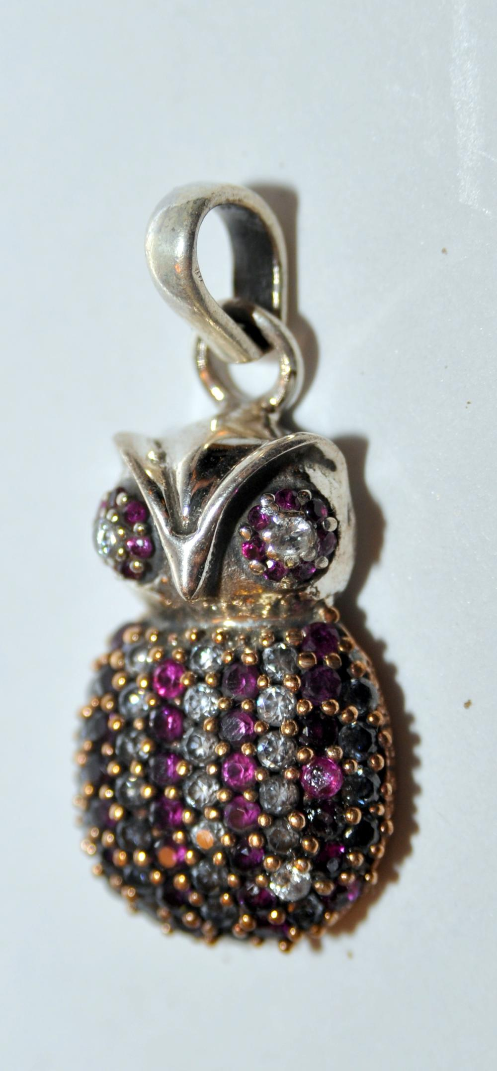 Lot 251: Owl pendant rubies sterling