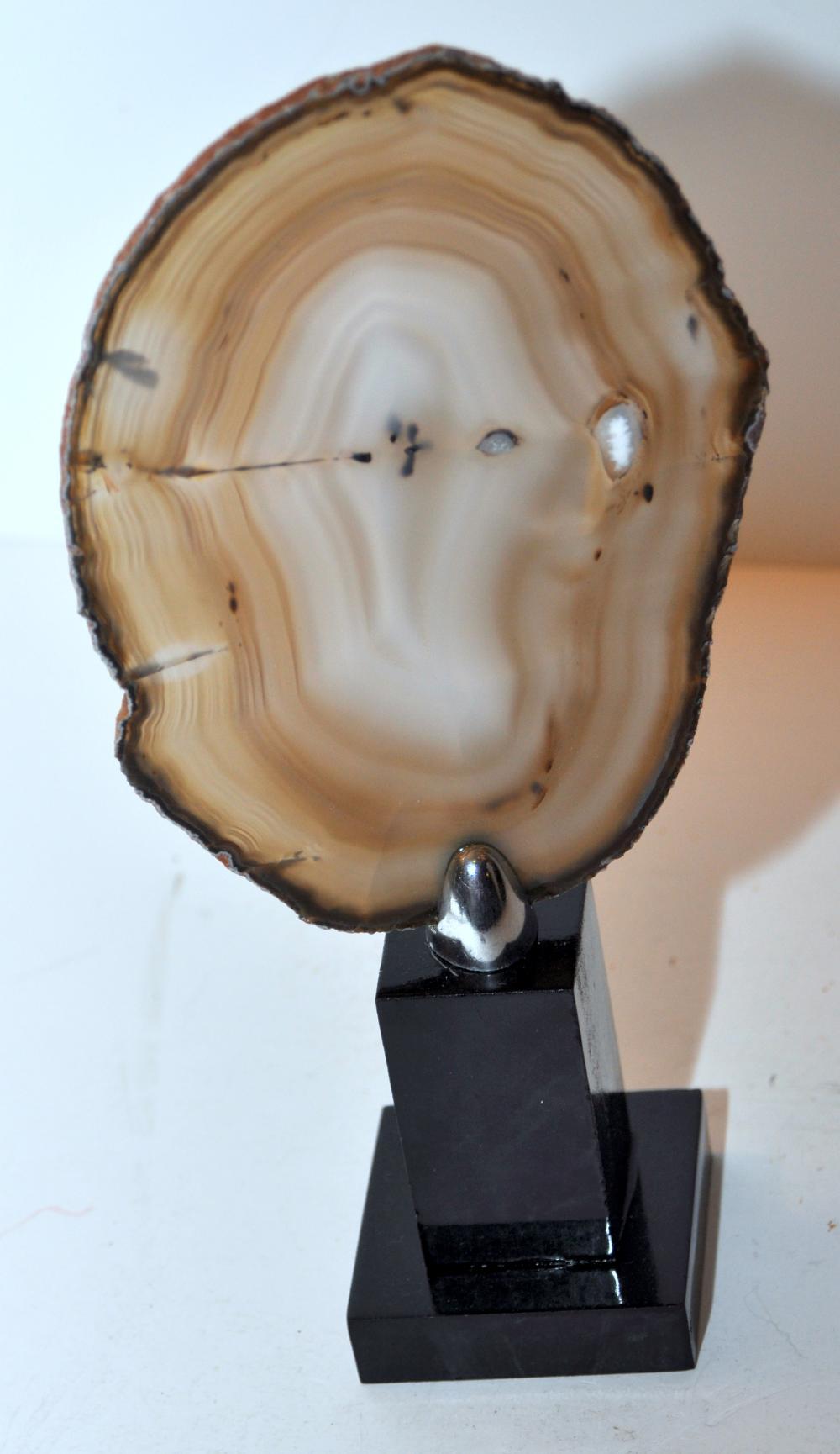Lot 257: Sliced agate specimen on stand