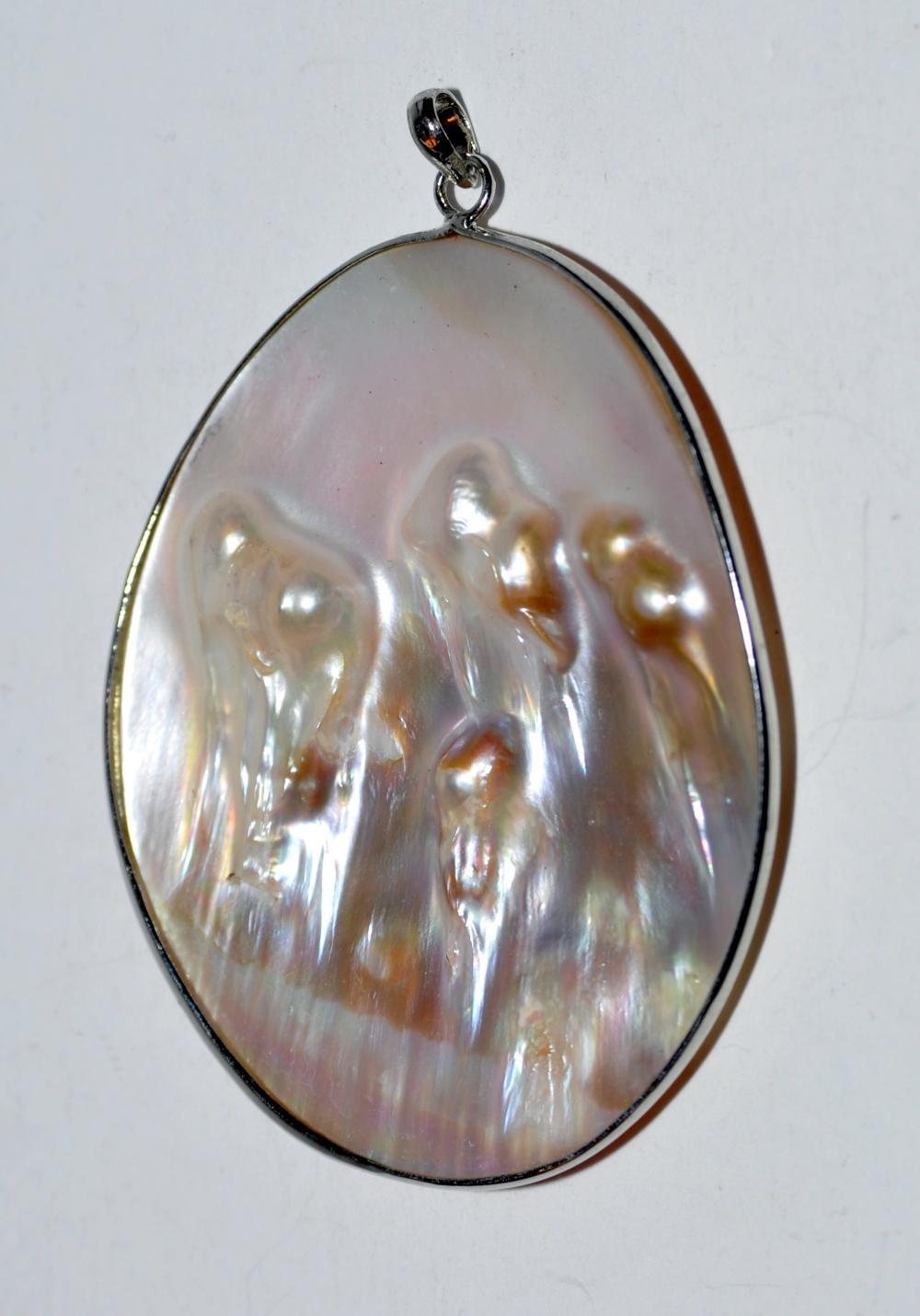 Blister pearl bezel set pendant reversible