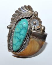 Lot 329: Sterling vintage turquoise bear claw ring