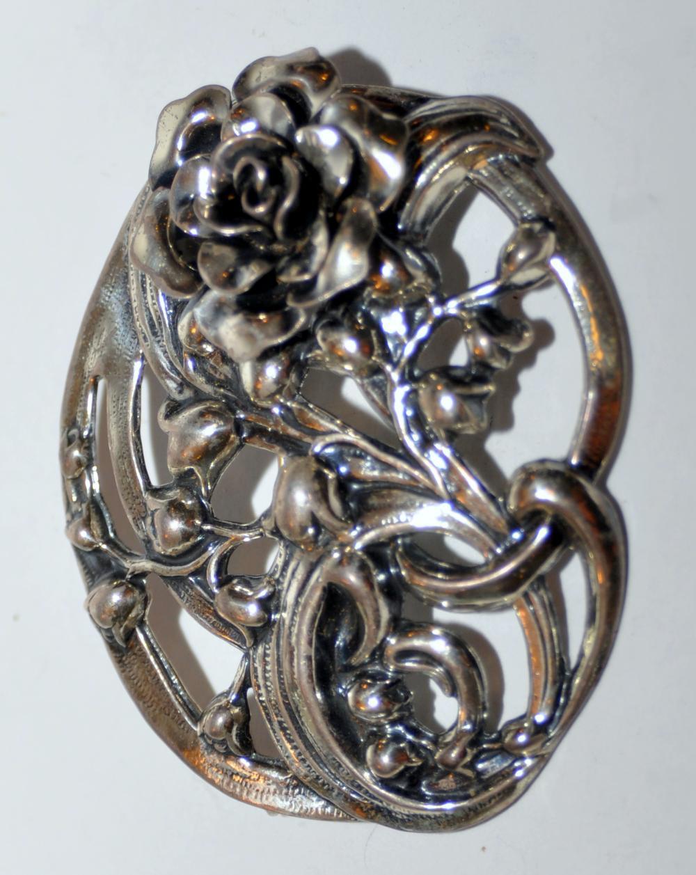 Lot 331: Vintage sterling floral pin
