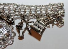 Lot 332: Sterling charm bracelet 1960 with 14 charms