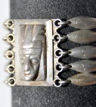 Lot 345: Mid century Mexican silver bracelet