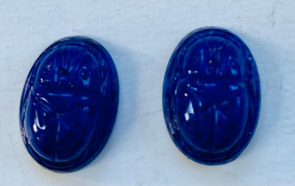 Glass cobalt blue oval scarabs