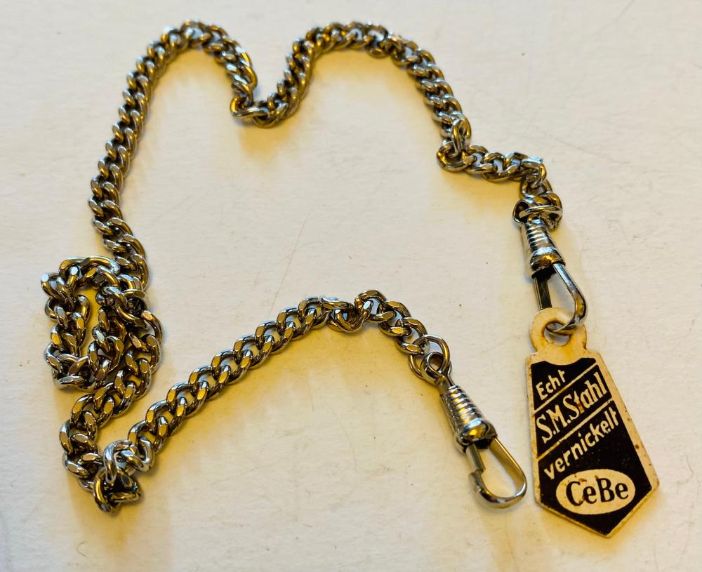 Old watch chain with original tag