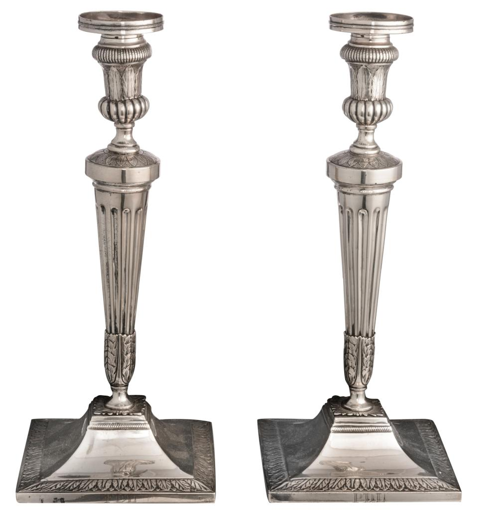 A pair of 1815 - 1830 period Belgian neoclassical silver candlesticks, H 33 - 33,3 cm/weight c. 1.120 g.