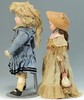 2 Dolls with French Purses