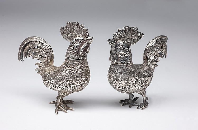 A PAIR OF FRENCH SILVER SALT SHAKERS