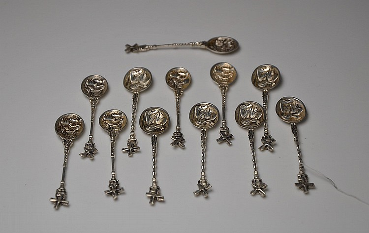 A SET OF TWELVE SILVER SPOONS
