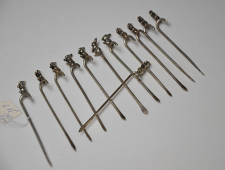 A SET OF TWELVE SILVER SKEWERS