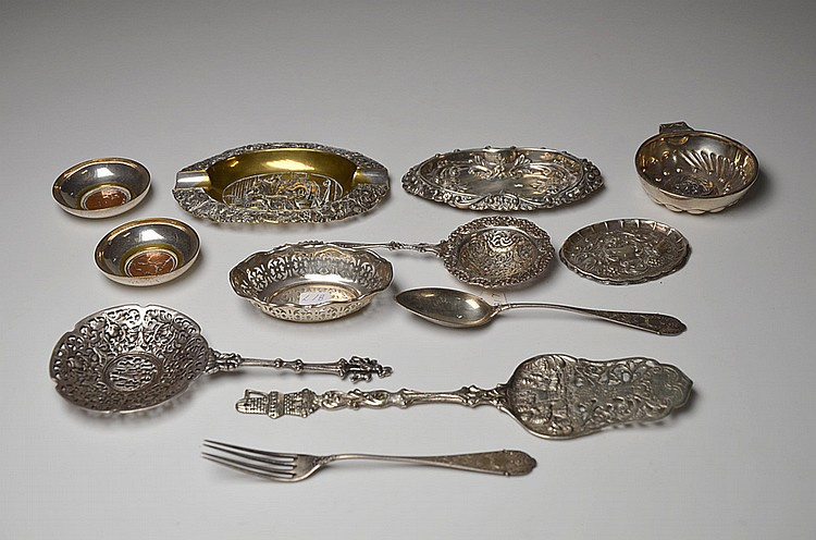A SET OF TWELVE SILVER AND METAL PIECES