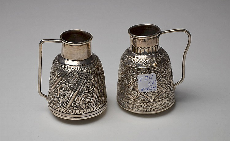 A PAIR OF SILVER JUGS