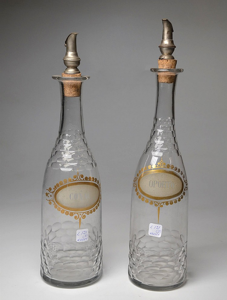 A PAIR OF CRYSTAL DECANTERS