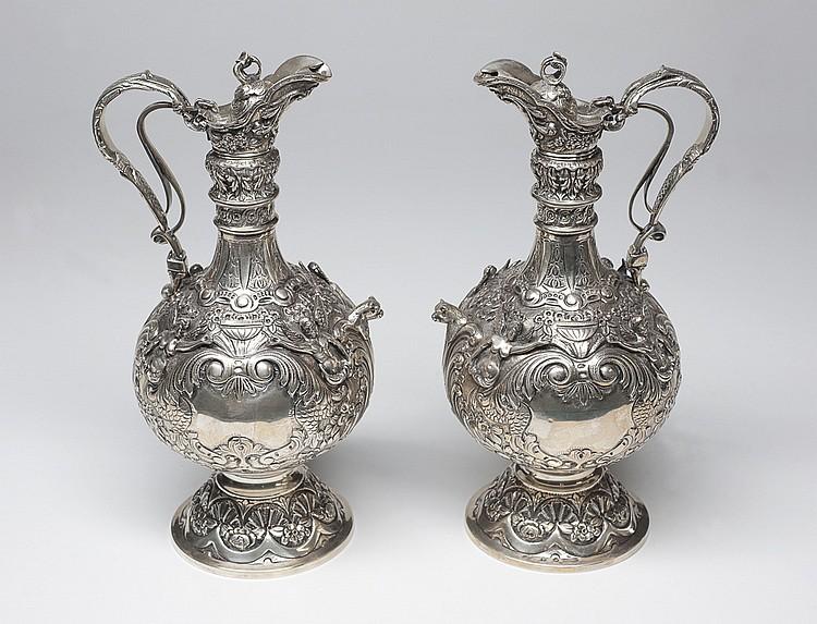 Estupenda pareja de jarras en plata española 916,