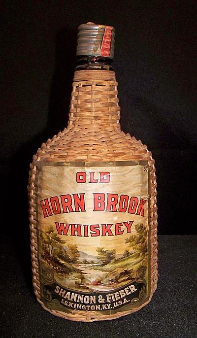 Old Horn Brook Whiskey Bottle in Wicker Holder