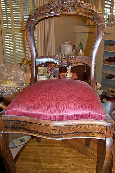 Pair of Rosewood Side Chairs with Rose Carved Back