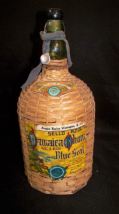 Wicker Covered Jug of Jamaiican Rum